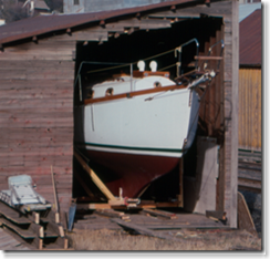 Coming out of the boatbuilding shed